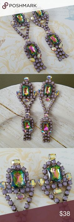 Vintage Czech glass rhinestone chandelier earrings The MOST gorgeous pair of vintage earrings I have seen in a while. The color is absolutely fabulous💕 Huge Czech AB rhinestones surrounded by lilac glass stone and accented with smaller AB rhinestones.  Pierced Excellent vintage condition  Signed Bijoux MG  A must for any vintage jewelry lover💕💕 Bijoux M.G Jewelry Earrings