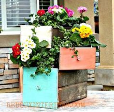 repurpose old drawers into planters, flowers, gardening, repurposing upcycling, I love the way the stacked drawers look with flowers spilling out