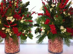 Pair of large arrangements - glass cylinders filled with candy canes. Christmas greens, holly, winterberry and narcissus. Floral design by Fillitwithflowers.com