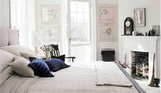 charming white room with blue striped accents ~ bedroom of Thomas O'Brien at his Long Island home