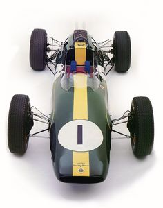 """the-stig: """"jacqalan: """" Lotus 25 Climax . 1962 """" So much love for Lotus' red steering wheels and the Coventry Climax script on the nose & cylinder heads. Lotus F1, Classic Sports Cars, Vintage Racing, Vintage Cars, Grand Prix, Chasing Cars, Montage Photo, Old Race Cars, Classy Cars"""