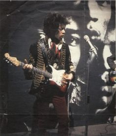soundcheck. Jimi is wearing the now famous British military jacket and playing the rarely seen sunburst Strat.