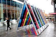 Artist creates walk-through triangular prism to offer a spectrum of colours in Manchester #installation #exhibition