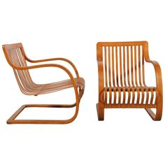 Charlotte Perriand - Pair of Lounge Chairs