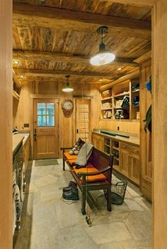 love an old log homey looking mud room maybe with old traditional