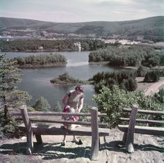 Woman and young boy view the scene over Freshwater Lake from the lookout above the entrance to Cape Breton Highlands National Park http://CaperMemories.Com