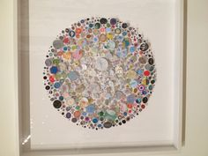Chris Kenny 'Capella' 2012. Mixed media construction with map pieces.  Collages created from found ephemera, usually presented on pins like natural history specimens. His interest in classical abstraction and the political nature of boundaries and cartography are combined in 'Capella' named after the 6th brightest star, Kenny displays a teeming galaxy of circular decorative graphic representation from white to black from centre outward. The circular composition suggests the view through a…