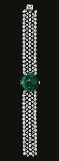 FINE  EMERALD  AND  DIAMOND  BRACELET,  CIRCA  1915	  	  Centring  on  a  circular  cabochon  emerald  highlighted  with  circular-  and  single-cut  diamond  set  motifs,  to  an  articulated  wide  band  designed  as  an  open  work  mesh  collet-set  with  circular-cut  diamonds,  within  a  millegrain-set  scalloped  border  similarly  set by josefina