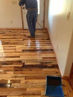 How to Build Wood Flooring from Wood Pallets DIY Project. By using wood taken from dissembling different wood pallets, a person will accumulate a beautiful selection of wood pieces that once assembled will create a patchwork of colors. Pallet Floors, Pallet Boards, Wood Flooring, Wooden Boards, Hardwood Floors, Flooring Ideas, Concrete Floors, Diy Concrete, Basement Flooring