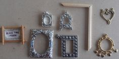 DIY miniature picture frames for the dollhouse - use recyclables like charms, scrap booking materials etc.