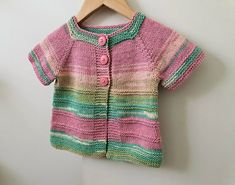 Handknitted short sleeved baby cardigan, sweater vibrant colours - baby girl handknit 6 to 12 months Knitted Baby Cardigan, Sweater Cardigan, Short Sleeve Cardigan, Long Sleeve, Vibrant Colors, Colours, Baby Girl Sweaters, Yarn Colors, Cool Eyes