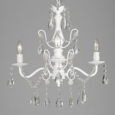This beautiful chandelier features a 4-light design and is decorated and draped with crystals that capture and reflect the light of the bulbs. The frame is wrought iron, adding the finishing touch to