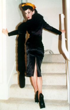 Dita in a black velvet suit w/stole