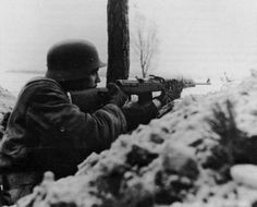 German soldier armed with a semi-automatic rifle Gewehr 43 in the trenches. The presence of the M1 in the hands of US troops pushed the Germans to try and produce a semi-auto long arm in sufficient quantities during the war. The effort failed but not before some intriguing designs saw the light of day.