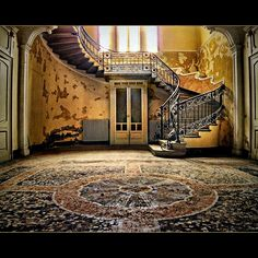 Abandoned with a beautiful floor and staircase...worth refurbishing