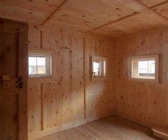 pine wood paneling with window glass