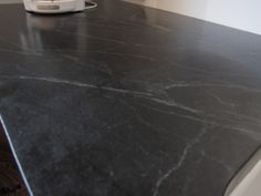 This pic will lead you to a page of pictures people have posted of their honed granite counter tops (some soap stone too)