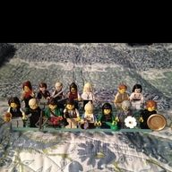 Lego Hunger Games characters: (first row) Haymitch, Peeta, Katniss, Gale, Prim, Rue, President Snow, Avox girl, (second row) Foxface, Marvel, Cato, Clove, Glimmer, Finnick, and Annie.