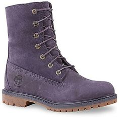 TIMBERLAND Women's Teddy Fleece Boot (Dark Purple 6.0 M)ly 1. Faux shearling lining. Premium waterproof leather upper. Seam-sealed constructionThese are beautiful, durable, and generally well-designed boots. However, I like them less than previous years styles because the tongue on this one is not partially attached at the sides anymore. The semi-attached feature was perfect for keeping out wind, water, snow, etc...