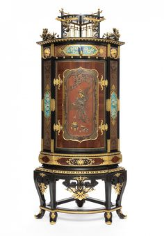 Christofle & C ie, manufacturer Paris, 1874-1878  Frame and base in ebony, rosewood, pear blackened, gilded door galvanic and patinated bronze, copper, silver, gold and cloisonné enamel