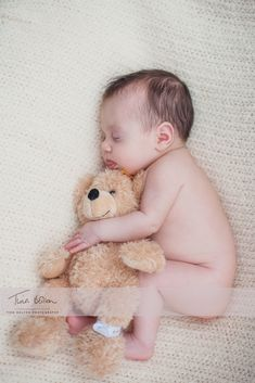 Newborn pictured with first teddy, photograph your baby on the same date each month next to the same teddy/toy to chart their growth