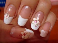 French manicure with flowers and rhinestones. I love the oval tips, btw!