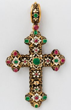 Swiss Gold and Enamel Cross Pendant A Swiss antique enamel 18 karat gold and enamel cross pendant, featuring an intricate black and white enamel decoration adorned with small emeralds and rubies. Circa: 1880's