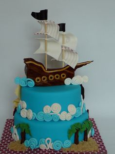 A pirate theme cake for Mathias, 6 years old. Marble cake with chocolate ganache covered with fondant. All details are fondant. The boat is fondant that I let dry few days so it holds on the cake. The map was drawn with food color pencil. I had palm trees in the back of the cake on little islands of brown sugar to look like sand.