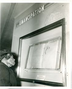 This photograph shows 88-year-old Mrs. Sally Fickland, a former slave, looking at the Emancipation Proclamation in 1947.  She would have been 3 years old when Lincoln signed the proclamation in 1862.  The document was in Philadelphia that day on the first stop on the Freedom Train tour. The Freedom Train carried the Emancipation Proclamation and the Bill of Rights across America. During the 413-day tour, 3.5 million people in 322 cities in 48 states viewed these records