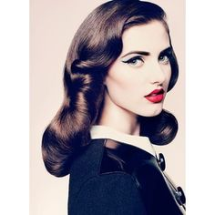 40's hair, winged eyeliner and red lips