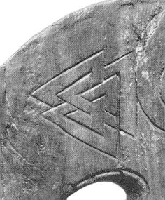 Valknut, the symbol of Odin. It's a Norse braid, and nine-fold path, and the binding symbol of Odinic rites.