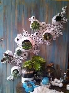 Anthropologie displays.... A whole albums worth.  Several ideas for wall sculpture inspiration.