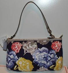 'BNWT COACH Madison Floral Large Wristlet Navy Multi/Sil' is going up for auction at  2pm Mon, Jul 15 with a starting bid of $40.