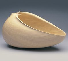CARVED FORM GRANT VAUGHAN - DESIGNS IN WOOD ..... A shape that is fluid and listening, a silent yawn of pleasure, at ease although seeming stretched.