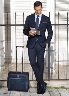 British model Ollie Edwards dons a navy suit from Damat.