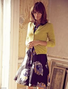 soft and mute without the eyeliner Helena Christensen models a floral print tea dress and chartreuse cardigan from the brand's Autumn/Winter collection