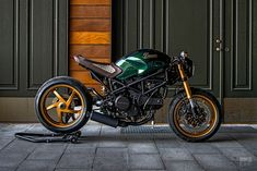 A Gucci-inspired Ducati a slinky, classic Triton from one of Britain's top builders, and an appreciation of Colin Seeley, who passed away last week. Ducati Monster 620, Ducati Monster Custom, Ducati Cafe Racer, Cafe Racer Bikes, Cafe Racers, Moto Guzzi, Moto Scrambler, Triumph Motorcycles, Cool Motorcycles