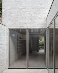 Compact living has never felt so spacious; enter Mews House, a two-bedroom home on a cobbled little street in Highgate, North London. Using a subtle palette of materials, architect Russell Jones has transformed a garage and overgrown garden in a recent. Russell Jones, Mews House, Brick Facade, Small Buildings, Brick And Mortar, Smooth Lines, House Extensions, Brickwork, Open Plan Living