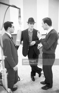 American trumpet player Chet Baker standing with two unidentified men in the record studio of the recording label Rca. 1961