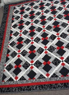 Customer review; I received the quilt yesterday, in excellent shape. Couldnt believe my eyes as I unfolded it and saw your awesome work, Debbie!! Talk about talent!   This artistic gorgeous Black, white and red, disappearing 9 patch quilt will add just the right touch to your bedroom. **The straight lines give this quilt a crisp clean look, the red accent ties everything together.  The dimensions of the block will change according to the size of quilt ordered. Fabrics may not match those…
