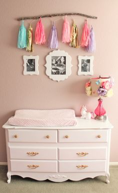 Fun Tassel Garland with Branch Decor over the Changing Table - fun nursery decor!
