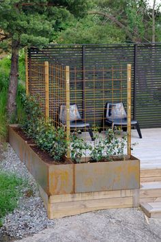 Raised beds with trellises for flowers/veggies to create a more private patio