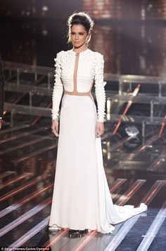 She's in fashion: Cheryl, who is mentoring the groups, teamed a floor-length white skirt with a statement jacket