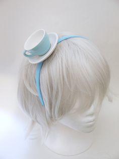 Blue  and White Ceramic Mini Tea Cup Hat -   Fasincator Alice  Headband. $24.00, via Etsy.