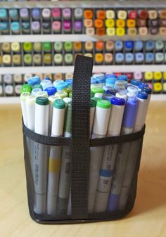 Copics in a Copic Carrying Case basket.