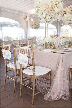 Large, tall, floral centerpieces in light pink and white. $$$$$