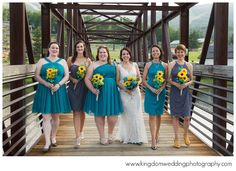mismatched bridesmaids dresses in teal & blue