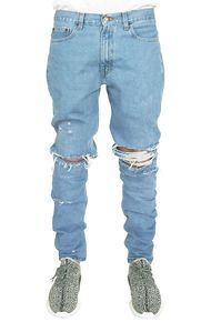 enslaved The Light Wash Ripped Tapered Jeans in Light Blue