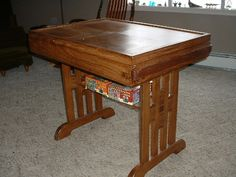 Puzzle table closed up, drawers slide into side to hold sorted puzzle pieces picture 2 of 2