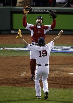 The Boston Red Sox win the World Series -- Boston Red Sox relief pitcher Koji Uehara (19) and catcher David Ross celebrate after Boston defeated the St. Louis Cardinals in Game 6 of baseball's World Series Wednesday, Oct. 30, 2013, in Boston. The Red Sox won 6-1 to win the series. (AP Photo/Charlie Riedel)